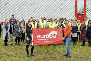 Andrew Baxter, managing director at Europa, with Menzies Response staff.