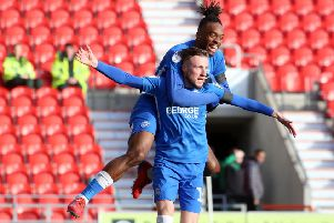 Ivan Toney helps George Cooper celebrate his goal for Posh at Doncaster. Photo: Joe Dent/theposh.com.