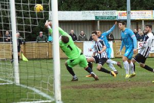 Rhys Hoenes fires home what proved to be the winning goal as Kettering Town claimed a 2-1 success at St Ives Town. Pictures by Peter Short