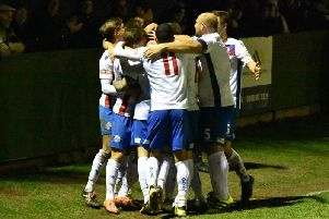 Sam Johnson is mobbed by his AFC Rushden & Diamonds team-mates after he scored the second goal in the fine 2-0 victory over Stratford Town at Hayden Road. Picture courtesy of HawkinsImages
