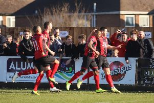 Aaron O'Connor celebrates after he grabbed the opening goal in Kettering Town's dramatic 2-1 victory over Rushall Olympic. Pictures by Peter Short