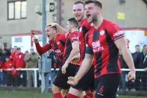 The Kettering Town players show their delight after Brett Solkhon's stoppage-time goal secured a 2-1 success over Rushall Olympic at Latimer Park. Pictures by Peter Short
