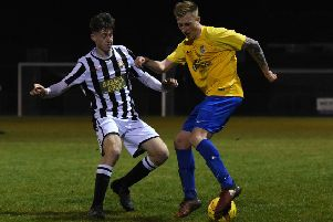 Luke Strachan of Peterborough Northern Star (stripes) in action against Pinchbeck United. Photo: Chantell McDonald. @cmcdphotos.