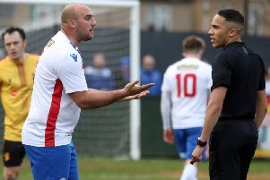 AFC Rushden & Diamonds captain Liam Dolman has a disagreement with the referee during the 1-1 draw with Alvechurch at Hayden Road. Pictures by Alison Bagley