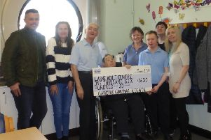 The Watson family have presented money raised from the Christmas lights display at their home to Larne Adult Centre.
