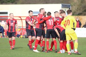 Man-of-the-match Gary Stohrer takes the congratulations after he scored Kettering Town's second goal in the 3-0 win over Banbury United. Pictures by Peter Short