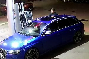The car being filled up. Picture: SWNS