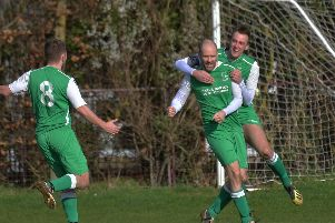 Earls Barton celebrate one of their goals in the 5-0 success over Burton United in the Premier Division. Pictures by Dave Ikin