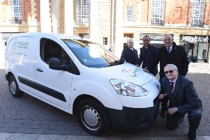 Cllrs Howard Fuller, Mohammed Farooq, Marco Cereste and John Holdich with an Aragon Direct Servicea van in Bridge Street