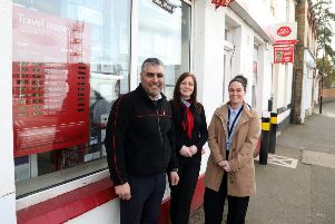 Thrapston postmaster Ricky Ghuman, supervisor Sue Keeble and  Post Office Network Sales Support Manager Nicola Handscombe with the new travel currency rate board. Picture: Alison Bagley NNL-190315-203448005
