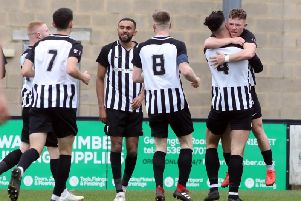 Jordon Crawford takes the congratulations after scoring the first of his three goals in Corby Town's 5-2 win over North Leigh at Steel Park. Pictures by Alison Bagley
