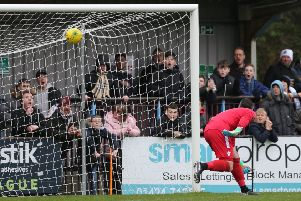 Cray Wanderers goalkeeper Nick Blue is beaten by Sam Cruttwell's wonder strike for the first Hastings United goal on Saturday. Picture courtesy Scott White
