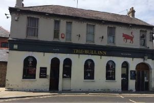 The Bull Inn closed in 2015. A sign has since been put up outside for restaurant use SUS-190318-175121001