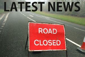 Police have closed the road EMN-190319-101946001