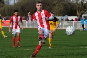 Brackley Town's Shane Byrne converts his penalty against Kidderminster Harriers. Photo: Jake McNulty