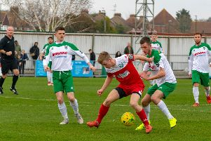 Ashton Leigh watches his man on his Bognor debut / Picture by Darren Crisp