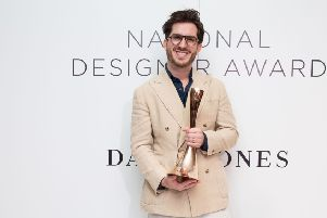 Christian Kimber with his award. Picture by Matthew Mallett SUS-190326-102550001