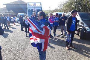 Many marchers were draped in Union Jack flags.