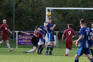 Goalmouth action from Thrapston Venturas 5-0 victory over Spratton Reserves in Division Three. Picture by Alison Bagley