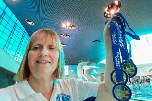 Hastings Seagull swimmer Laura Quye proudly displays her five medals