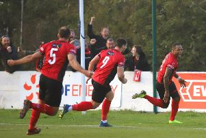 Aaron O'Connor's face tells the story as he wheels away after scoring Kettering Town's stoppage-time winner in the 1-0 success at Leiston, which put them on the brink of the title. Pictures by Peter Short