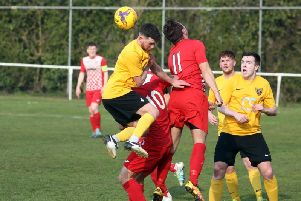 Action from Rothwell Corinthians' 1-1 draw with Harborough Town in the UCL Premier Division. Pictures by Alison Bagley