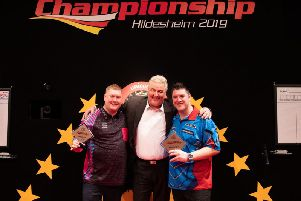 Kettering's Ricky Evans (left) and German Darts Championship winner Daryl Gurney show off their trophies after their final clash. Picture courtesy of PDC