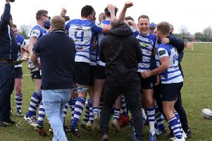 The celebrations begin after Kettering won the Midlands One East title with a 47-8 victory at local rivals Wellingborough. Pictures by Alison Bagley