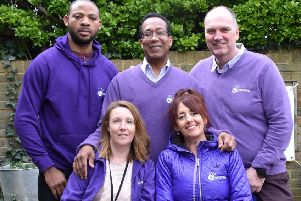 Back row (L-R): Julius Anika (student social worker), Derek Hall (agency social worker) and Rob Edworthy (registered manager). Front row (L-R): Sam Stevens (business support assistant) and Dee Martin (business support officer).''Other staff not pictured are Katie Edworthy (director) and Sarah Errington (business support officer).