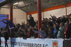 The Kettering Town fans are set to travel in numbers to Halesowen Town this weekend to see if their team can lift the title. Picture by Peter Short