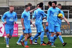 The Corby Town players celebrate one of their goals during the 2-1 victory at Aylesbury United last weekend. Picture by David Tilley