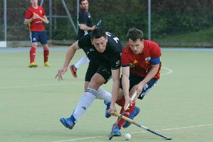 City of Peterborough skipper Ross Booth (red) battles for possession in the play-off match with Fareham. Photo: David Lowndes.