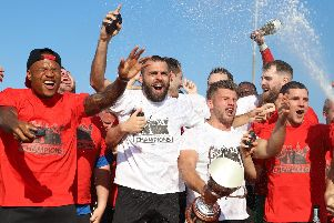Kettering Town's players enjoy their title party