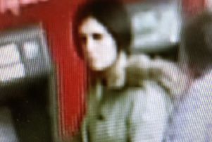 CCTV image of the 'hugging scammer' in Chichester, released by Sussex Police SUS-190422-101740001