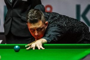 Kyren Wilson booked his place in the second round of the Betfred World Championship