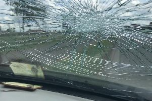The view through the smashed windscreen from inside the car. Pic courtesy of Northamptonshire Police.