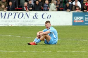 Jordon Crawford cuts a lonely figure after the final whistle as Corby Town missed out on promotion after their 4-3 defeat at Bromsgrove Sporting in the play-off final. Pictures by Alison Bagley