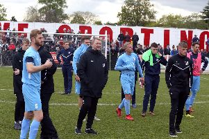 The Corby Town players were left shattered after their promotion hopes were ended in the play-off final at Bromsgrove Sporting. Pictures by Alison Bagley