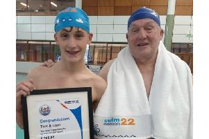 Liam Culley with his grandfather Tom Carr after completing the Swim22 challenge, but the duo aren't stopping there - they're to complete an extra 4.2 miles to make it a marathon
