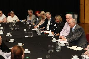 Alex Brazier (fourth from right) hosts the roundtable in Corby yesterday