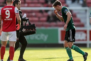 Derry City midfielder, Greg Sloggett leaves the pitch for treatment moments before St Pat's scored.