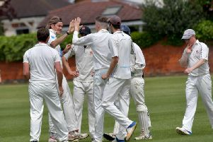Old Northamptonians celebrate a wicket during their Premier Division win over Brigstock. Pictures by Dave Ikin