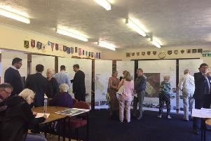 Residents at the exhibition held at the Higham Ferrers Bowls Club yesterday.