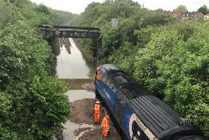 The bank collapsed into the side of this train. There is still flooding on the line.