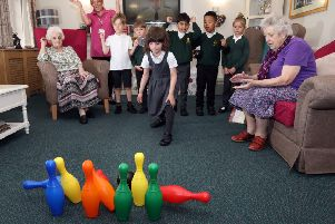 Pupils play with the residents.