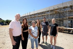 Pictured last year Kevin Byrne, left, and the team that were hoping the the building could be a gym..ks180350-3 SUS-180723-190904008