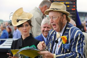 John McCririck and Tanya Stevenson at work in the Goodwood betting ring / Picture by Malcolm Wells