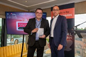 BSM's Julian Welch, left, collects the  Top Agency Instructions award from Damian Wild, editor of Estates Gazette.