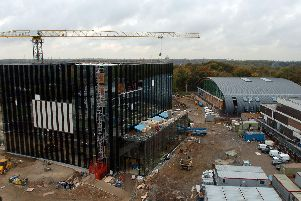 A crane hovers over the huge Parkland Gateway building site