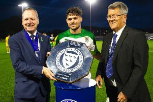 Rocks skipper Harvey Whyte with the community shield / Picture by Tommy McMillan